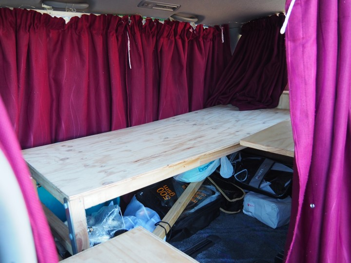 Bare bedframe in our camper car in New Zealand