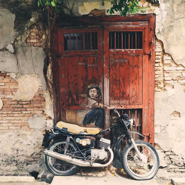 Boy On Motorbike - A Penang Street Art Painting By Ernest Zacharevic