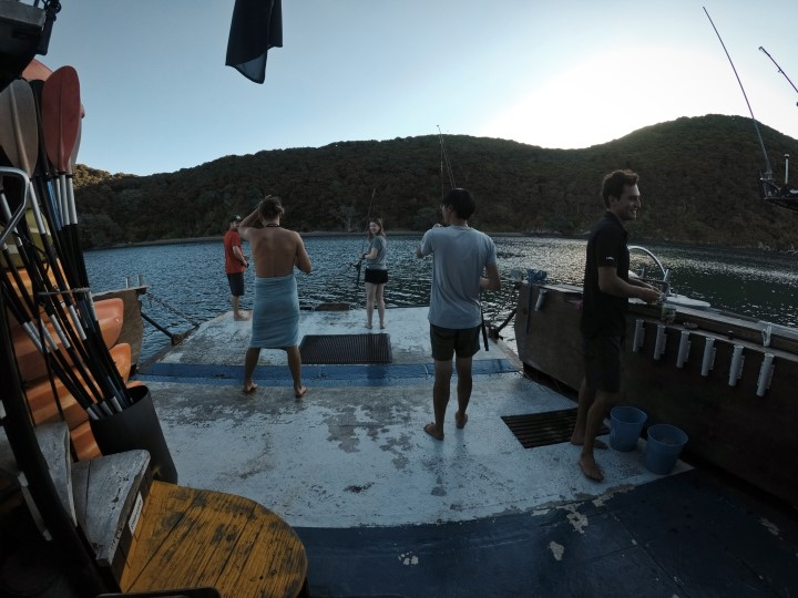 Fishing off the back deck with The Rock Adventure Cruise in the Bay of Islands, New Zealand