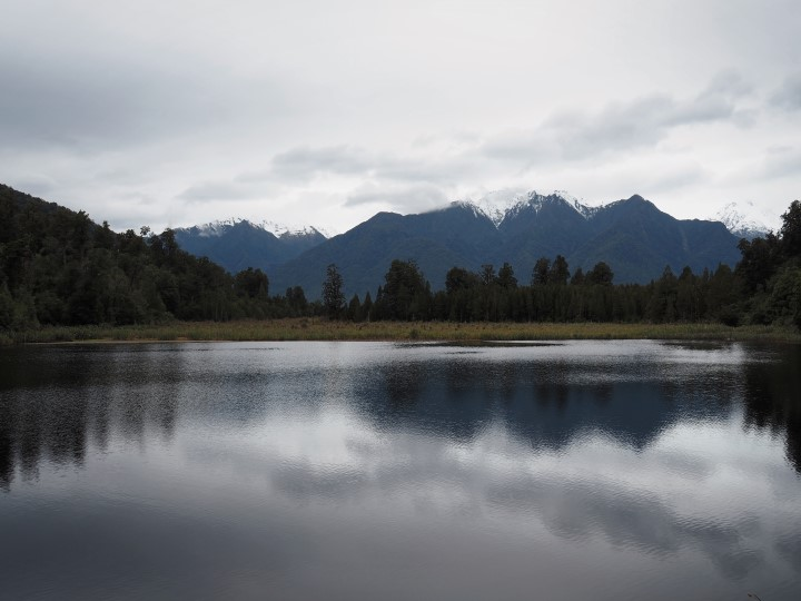 Lake Matheson at unfavorable weather conditions (windy day) - more on visiting New Zealand during the winter months on www.travelswithsun.com