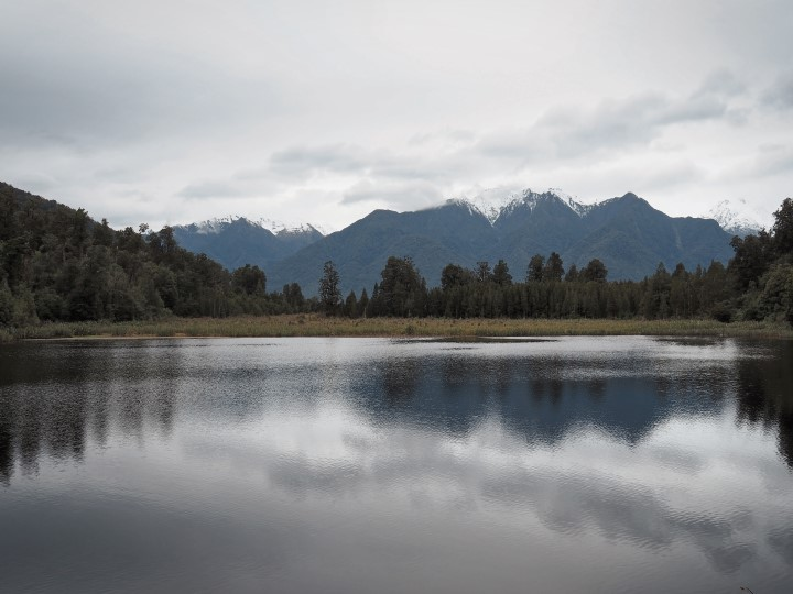 Lake Matheson on a windy and cloudy day - - One of the highlights in our 1 month self-drive trip around New Zealand during winter. More on www.travelswithsun.com