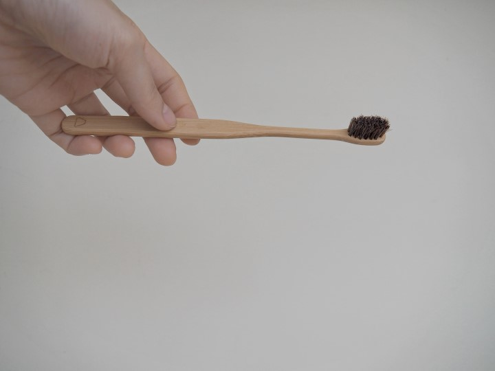 Slim bamboo toothbrush with horsehair bristles - zero waste haul from Frangipani; review on www.travelswithsun.com