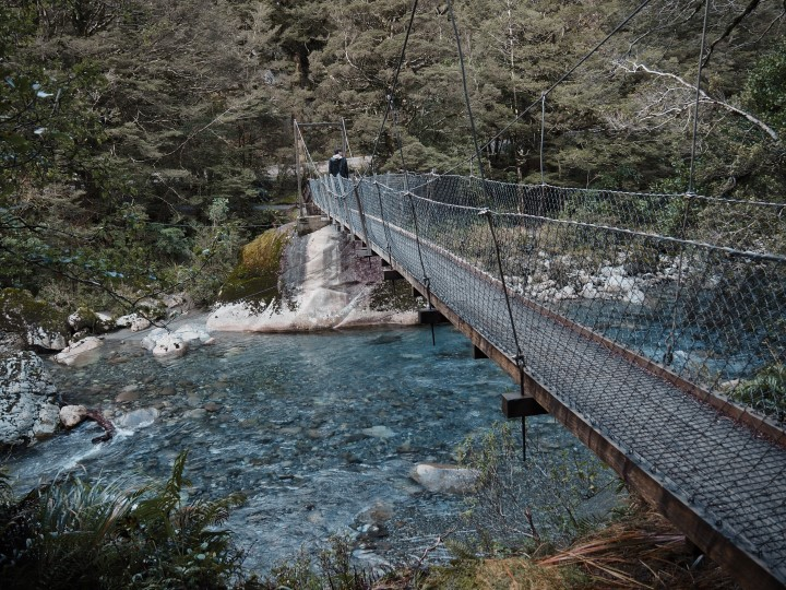 The swingbridge at the start of the Lake Marian trail in Fiordland - more on what to expect on this hike on www.travelswithsun.com