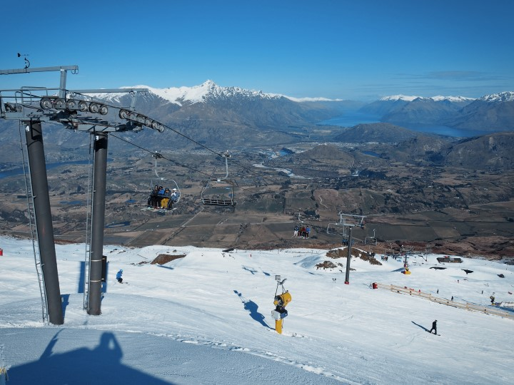 View of Queenstown from the summit of Coronet Peak - More on first time skiing in Coronet Peak on www.travelswithsun.com