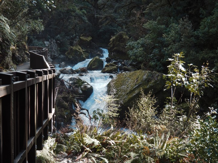Waterfalls before Lake Marian in Fiordland - more on what to expect on this hike on www.travelswithsun.com
